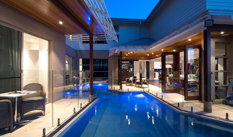 Residential Wrap Around Infinity Pool Evening